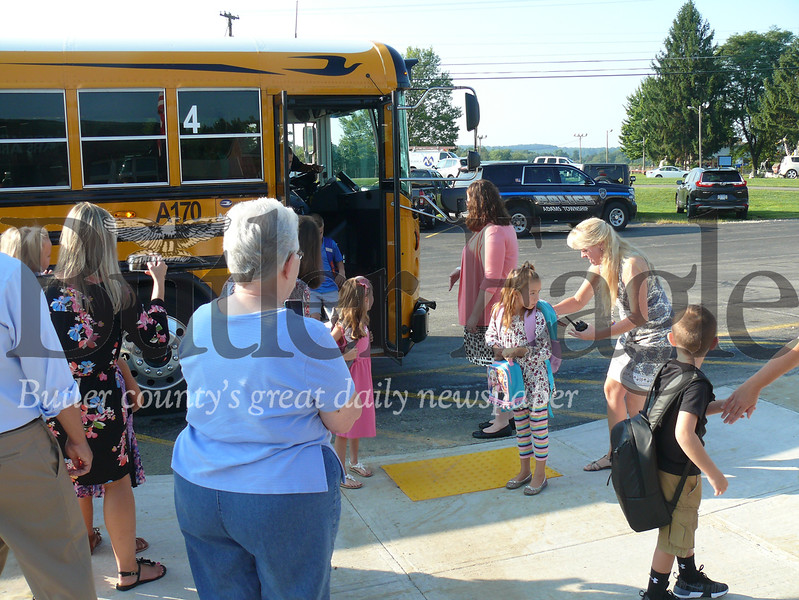 Parents and teachers await the arrival of students Wednesday at the Mars Primary Center.