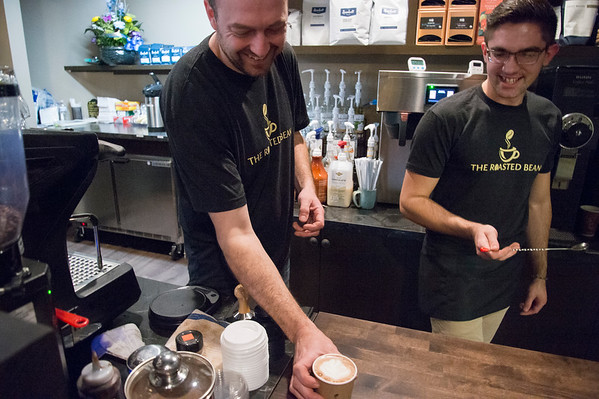 01/27/20 Wesley Bunnell | StaffrrCo-owner Doug Lamonthe, L, and employee Nathan Virovoy, serve a hot chocolate at the Roasted Bean coffee shop. The shop which opened approximately two weeks ago is located at 934 Terryville Ave in Bristol.