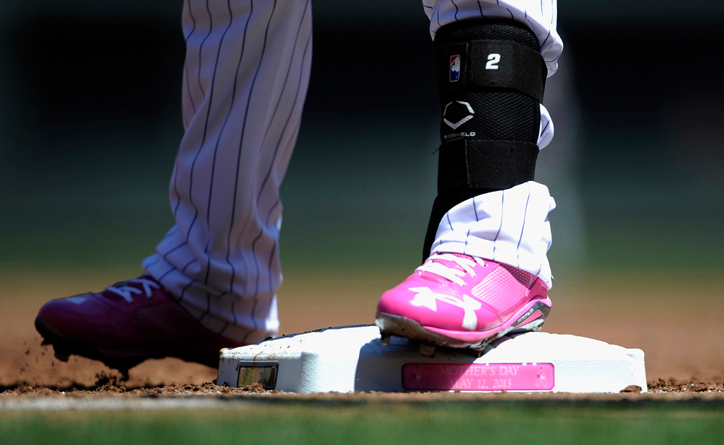 . Twins second baseman Brian Dozier sports pink spikes as he stands on first base with a lead-off single during the first inning of the game against the Orioles. Players wore pink clothing and used pink bats to raise awareness for breast cancer on Sunday. (Photo by Hannah Foslien/Getty Images)