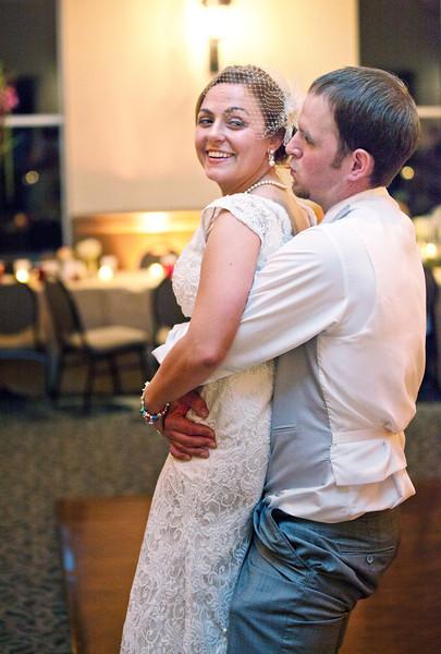 Groom picking up bride on dance floor.jpg