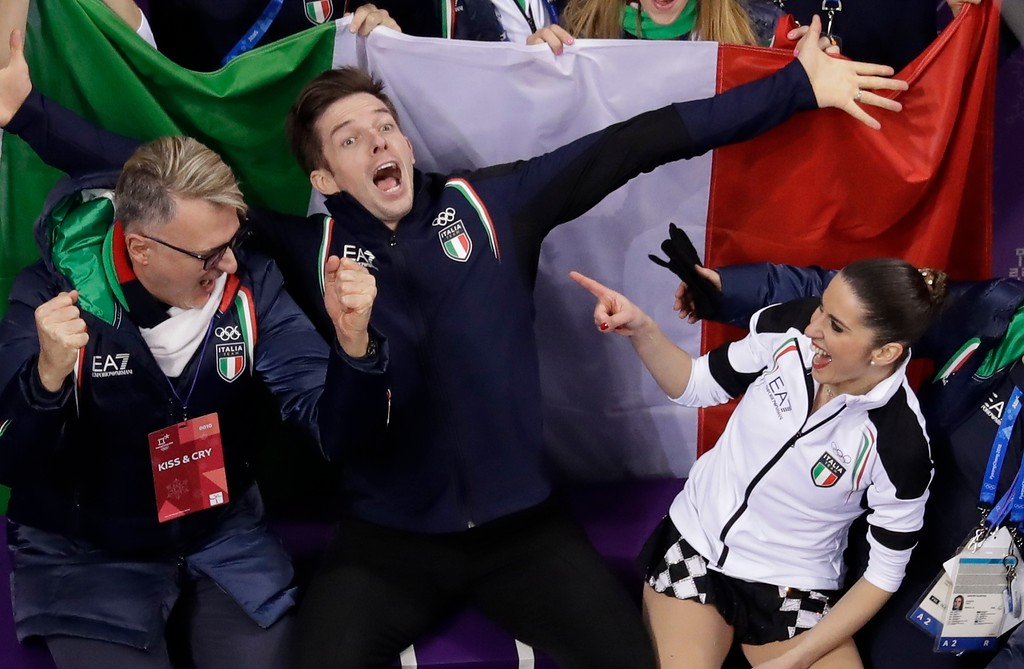 . Valentina Marchei and Ondrej Hotarek, of Italy, reacts after performing in the team event pair skating in the Gangneung Ice Arena at the 2018 Winter Olympics in Gangneung, South Korea, Sunday, Feb. 11, 2018. (AP Photo/Morry Gash)