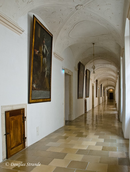 Arched and tiled hallway at Melk Abbey.  Wood door for fire-tending.
