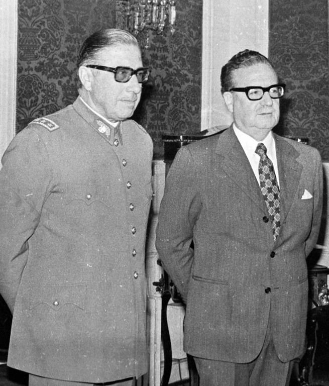 . In this Aug. 23, 1973 file photo, Chilean Gen. Augusto Pinochet, left, and President Salvador Allende attend a ceremony naming Pinochet as commander in chief of the Army. As Chile marks the 40th anniversary of the coup led by Gen. Augusto Pinochet overthrowing Allende, on Wednesday, Sept. 11, 2013, Allende\'s legacy is thriving. A socialist is poised to reclaim the presidency and a new generation, born after the return to democracy in 1990 has taken to the streets in vast numbers to demand the sort of social goals Allende promoted. (AP Photo/Enrique Aracena, File)