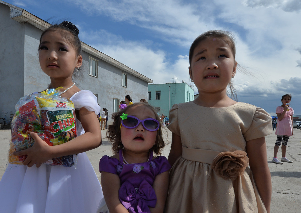 . Mongolian children attend a carnival to celebrate International Children\'s Day at the Mongolian town of Bayangol on June 1, 2013.  Mongolia, along with current and former Communist countries, celebrates their Children\'s Day on June 1. MARK RALSTON/AFP/Getty Images