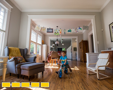 The Potter family home is located in Adair Park.  where 2-year-old Luke Potter warms up in the family room before a bike ride to the Westside Trail Beltline.  (Jenni Girtman / Atlanta Event Photography)