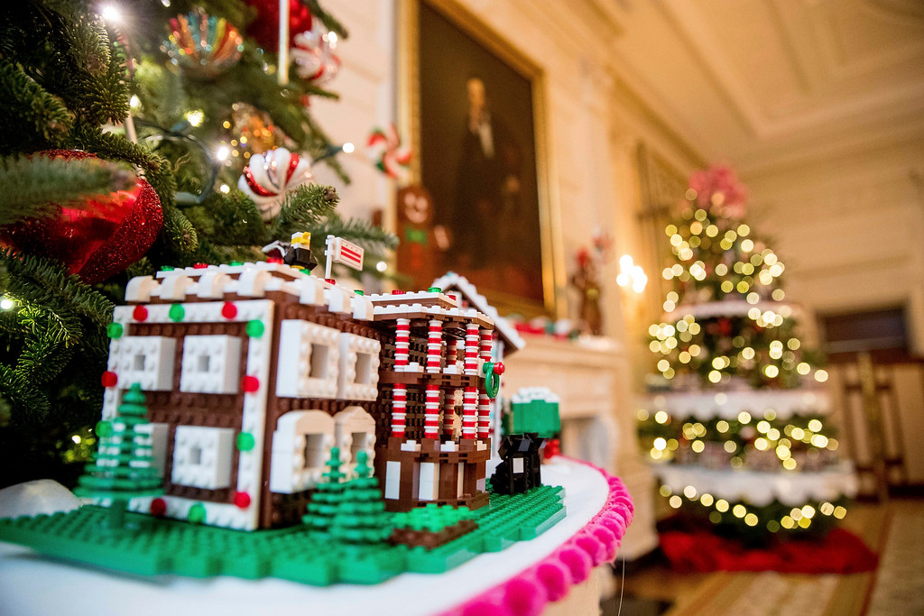 . The White House, is one of the fifty-six LEGO gingerbread houses, one for each state and territory, displayed in the trees in the State Dinning Room at the White House during a preview of the 2016 holiday decor, Tuesday, Nov. 29, 2016, in Washington. Each of the LEGO gingerbread houses are a one-of-a-kind creation and feature colors, architecture styles and details that pay tribute to each state or territory.  This house was made for the District of Columbia.  (AP Photo/Andrew Harnik)