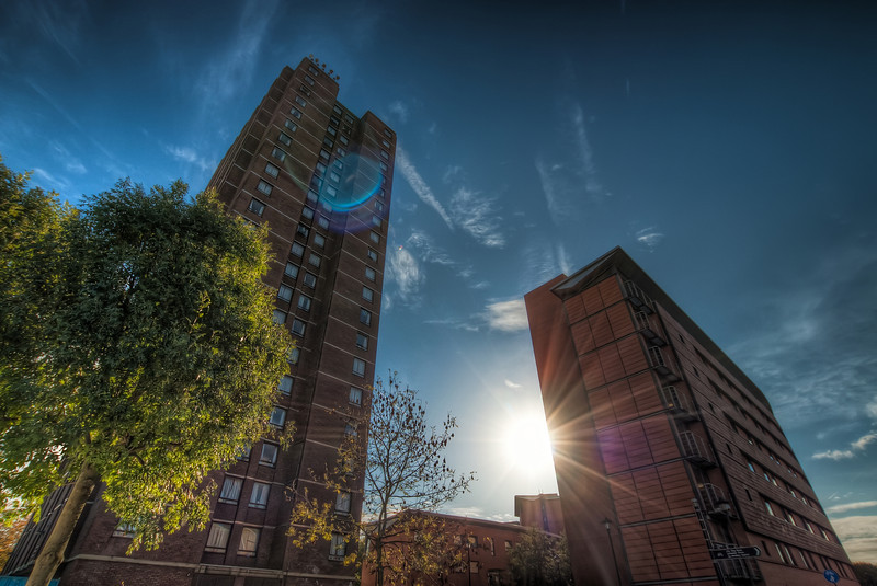 """Shot from Birmingham  One of the more """"random"""" shots I took in Birmingham, UK. I was just walking along the street and I really liked how the sun was behind the building. So I took this shot :)  HDR from three shots, taken with Canon 450D with Sigma 10-20mm lens, handheld.."""