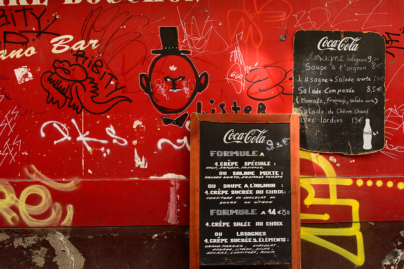 Graffitti on Restaurant wall in Montmartre - Why does this have to happen - see next picture taken 2 years ago.