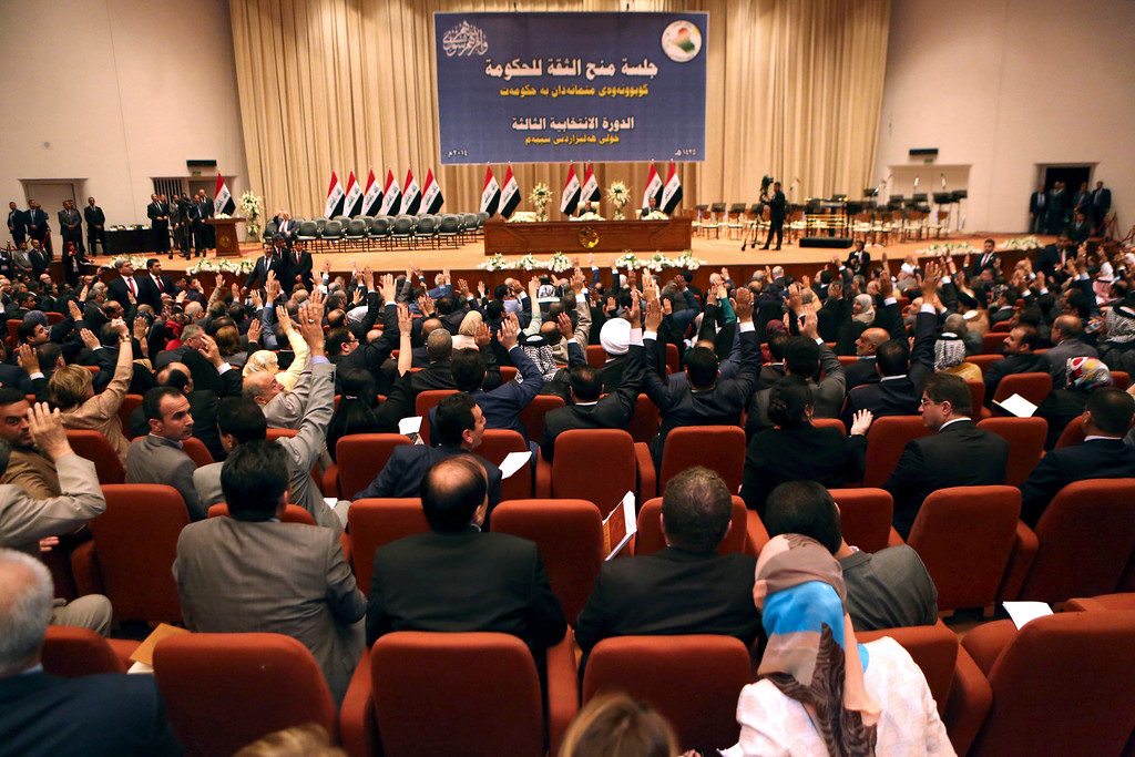 . Iraqi lawmakers attend the session to approve the new government in Baghdad, Iraq, Monday, Sept. 8, 2014.  Iraq\'s parliament officially named Haider al-Abadi the country\'s new prime minister late Monday and approved most of his proposed Cabinet amid calls by the Arab League for its members to combat the Sunni militant group violently advancing across Iraq and Syria. (AP Photo/Hadi Mizban, Pool)