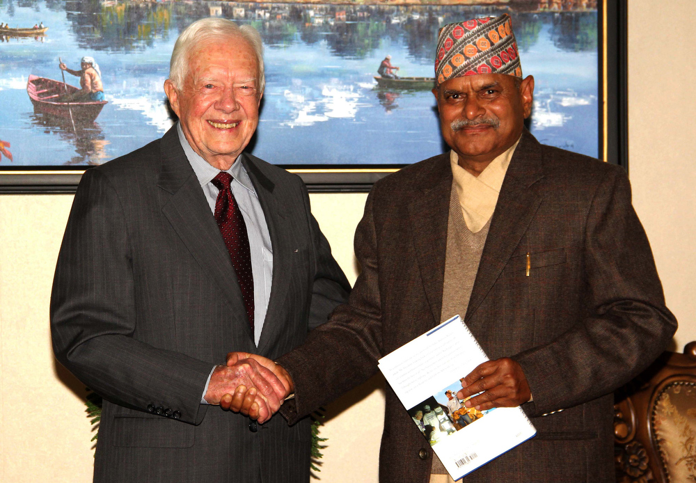 . In this handout photograph released by The Nepalese President\'s Office on March 30, 2013, former US Presdident Jimmy Carter (L) shakes hand with Nepalese President Ram Baran Yadav (R) during a meeting at the office of the President in Shital Niwas in Kathmandu on March 29, 2013.  Carter has arrived in Kathmandu on four day visit.  AFP PHOTO / PRESIDENT\'S OFFICE
