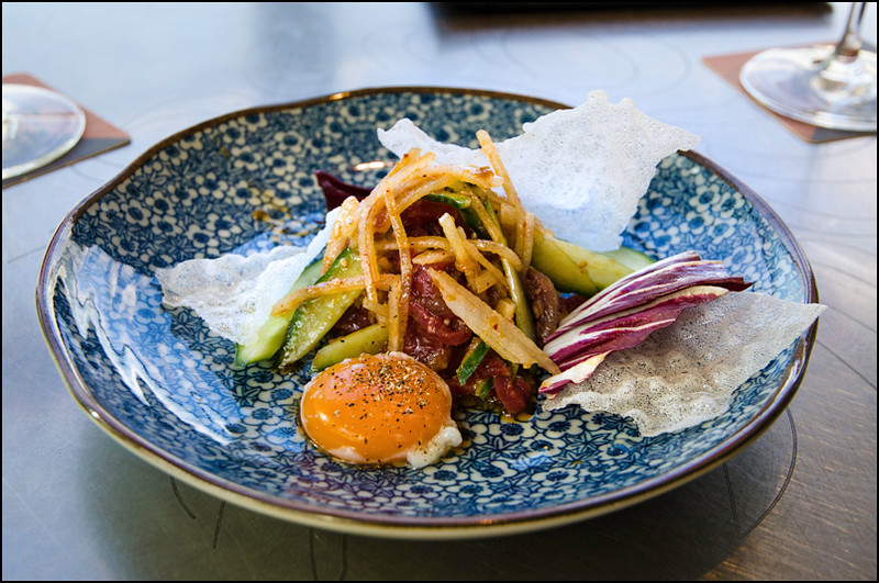 Korean cured beef tartare, cucumber, nashi pear, soy dressing, slow cooked egg yolk, sesame ($18)