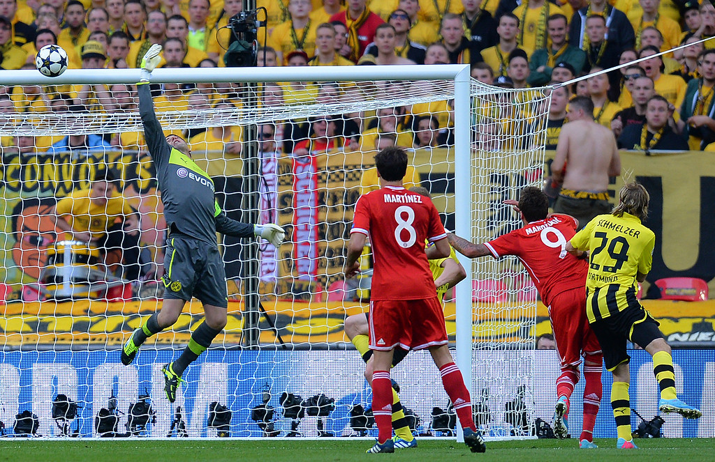 . Borussia Dortmund\'s German goalkeeper Roman Weidenfeller (L) makes a save during the UEFA Champions League final football match between Borussia Dortmund and Bayern Munich at Wembley Stadium in London on May 25, 2013   ANDREW YATES/AFP/Getty Images