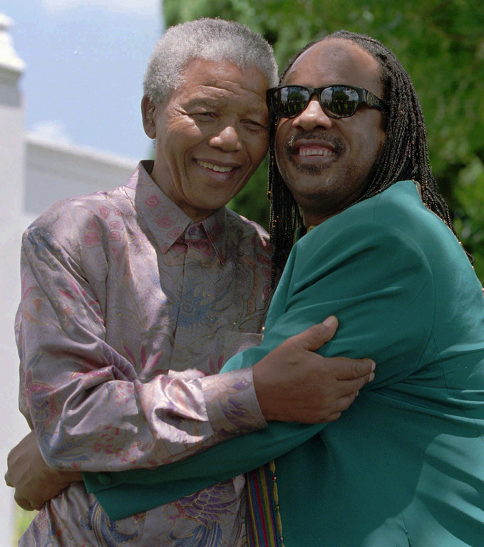 . South African President Nelson Mandela hugs the famous American singer/composer Stevie Wonder at Mandela\'s residence in Pretoria, Tuesday February 6, 1996. Stevie Wonder is in South Africa on a private visit, but is set to perform here later this year.(AP Photo/Adil Bradlow)