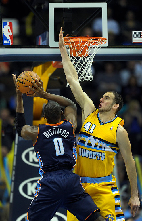 . Denver center Kosta Koufos (41) tried to block a shot from Bobcats center Bismack Biyombo (0) in the second half. The Denver Nuggets defeated the Charlotte Bobcats 110-88 at the Pepsi Center Saturday night, December 22, 2012.  Karl Gehring/The Denver Post