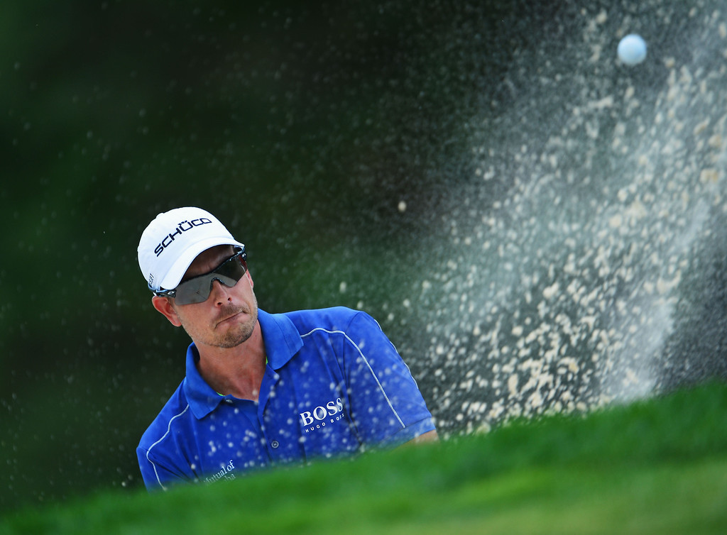 . Henrik Stenson of Sweden hits his bunker shot on the 14th hole during the final round of the 95th PGA Championship on August 11, 2013 in Rochester, New York.  (Photo by Stuart Franklin/Getty Images)