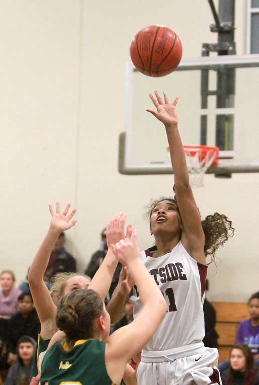 . Eastside Prep\'s Chacitty Cunningham  attempts a layup against Pinewood\'s Kendahl Wallis-Lang, center, during a game in the third quarter at Eastside Prep High School on Tuesday, Feb. 5, 2013.     (Kirstina Sangsahachart/ Daily News)
