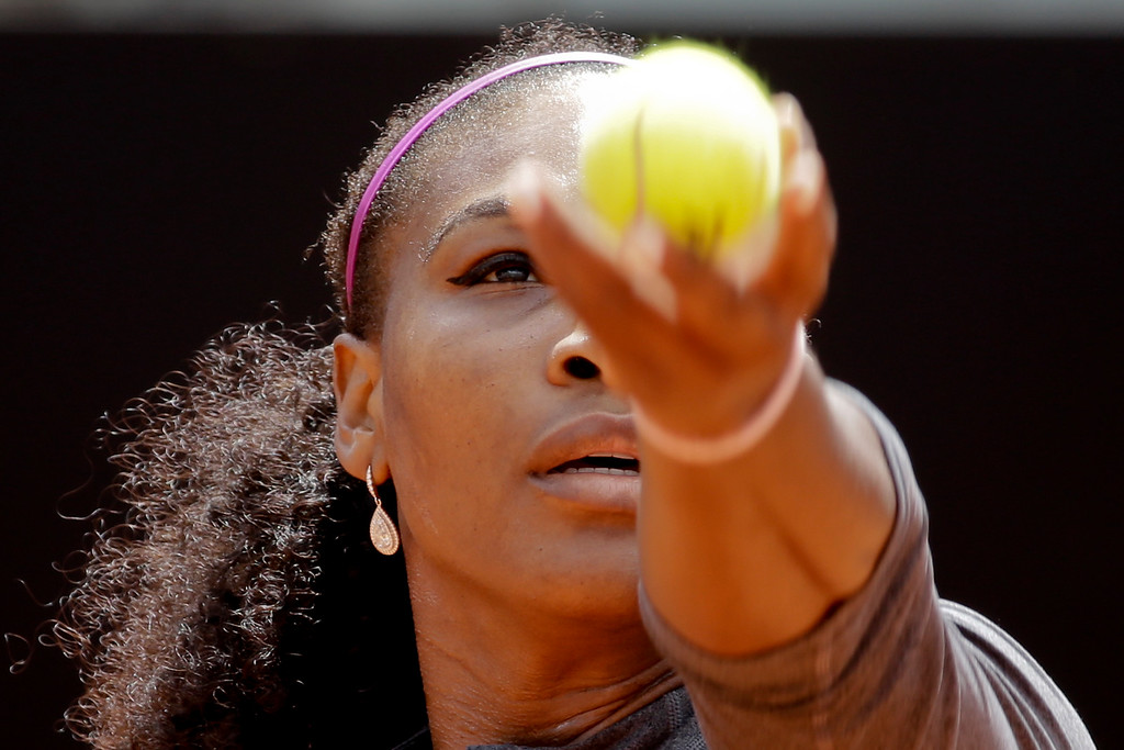 . Serena Williams of the US serves the ball to Christina McHale of the US during their match at the Italian Open tennis tournament, in Rome, Thursday, May 12, 2016. (AP Photo/Andrew Medichini)