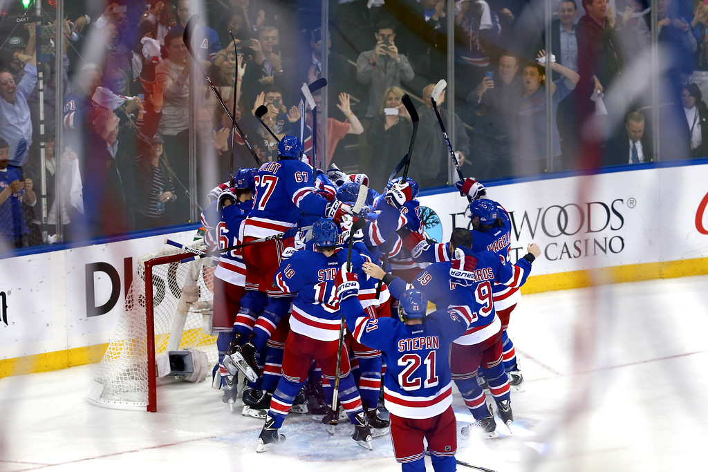 . The New York Rangers celebrates after defeating the Montreal Canadiens in Game Six to win the Eastern Conference Final in the 2014 NHL Stanley Cup Playoffs at Madison Square Garden on May 29, 2014 in New York City. The New York Rangers defeated the Montreal Canadiens 1 to 0.  (Photo by Elsa/Getty Images)