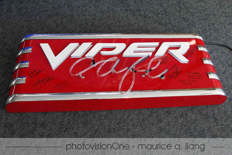 Autographed sign will be auctioned off to raise money for charity.
