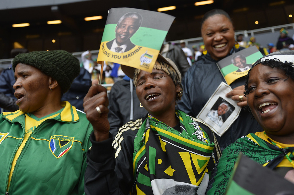 . Women attend the memorial service of South African former president Nelson Mandela at the FNB Stadium (Soccer City) in Johannesburg on December 10, 2013. Mandela, the revered icon of the anti-apartheid struggle in South Africa and one of the towering political figures of the 20th century, died in Johannesburg on December 5 at age 95. ODD ANDERSEN/AFP/Getty Images