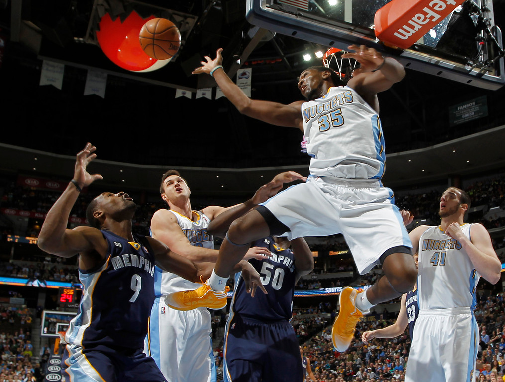 . Denver Nuggets forward Kenneth Faried, front, reaches out to block a shot from Memphis Grizzlies guard Tony Allen, back left, as Nuggets forward Danilo Gallinari, second from left, of Italy, Grizzlies forward Zach Randolph, third from left, and Nuggets forward Kosta Koufos look on in the first quarter of an NBA basketball game in Denver, Friday, March 15, 2013. (AP Photo/David Zalubowski)