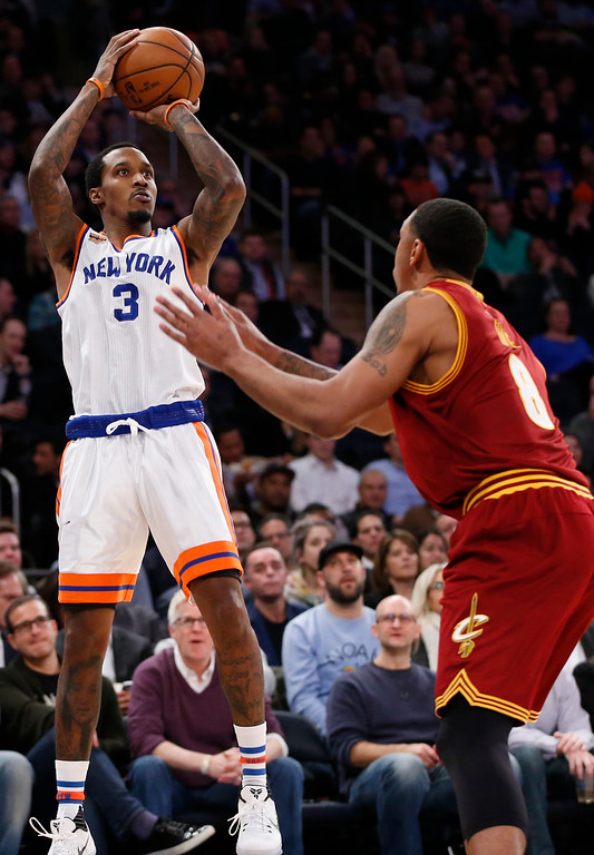 . New York Knicks guard Brandon Jennings (3) shoots with Cleveland Cavaliers forward Channing Frye (8) defending in the second half of an NBA basketball game at Madison Square Garden in New York, Wednesday, Dec. 7, 2016. The Cavaliers crushed the Knicks 126-94. (AP Photo/Kathy Willens)