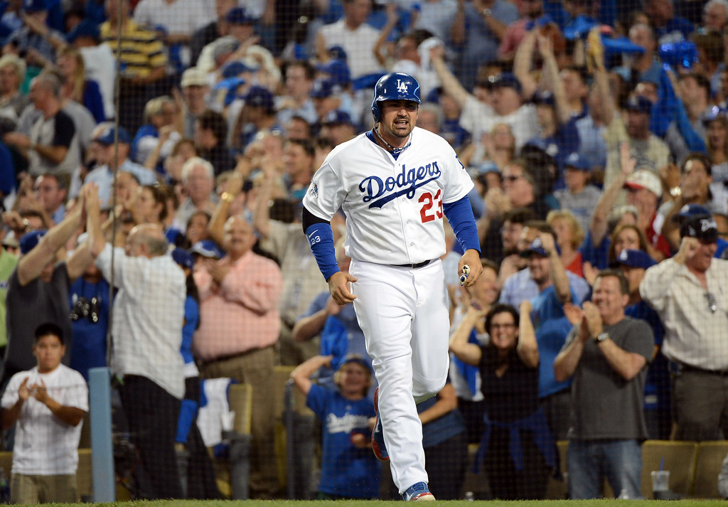 . Adrian Gonzalez scores off Yasiel Puig\'s single to center in the fourth during the NLCS at Dodger Stadium against the St. Louis Cardinals Tuesday, October 15, 2013. (Photo by David Crane/Los Angeles Daily News)