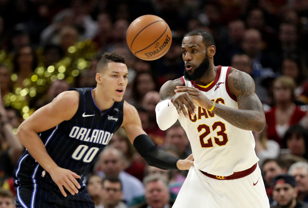 . Cleveland Cavaliers\' LeBron James (23) passes against Orlando Magic\'s Aaron Gordon (00) in the second half of an NBA basketball game, Thursday, Jan. 18, 2018, in Cleveland. (AP Photo/Tony Dejak)