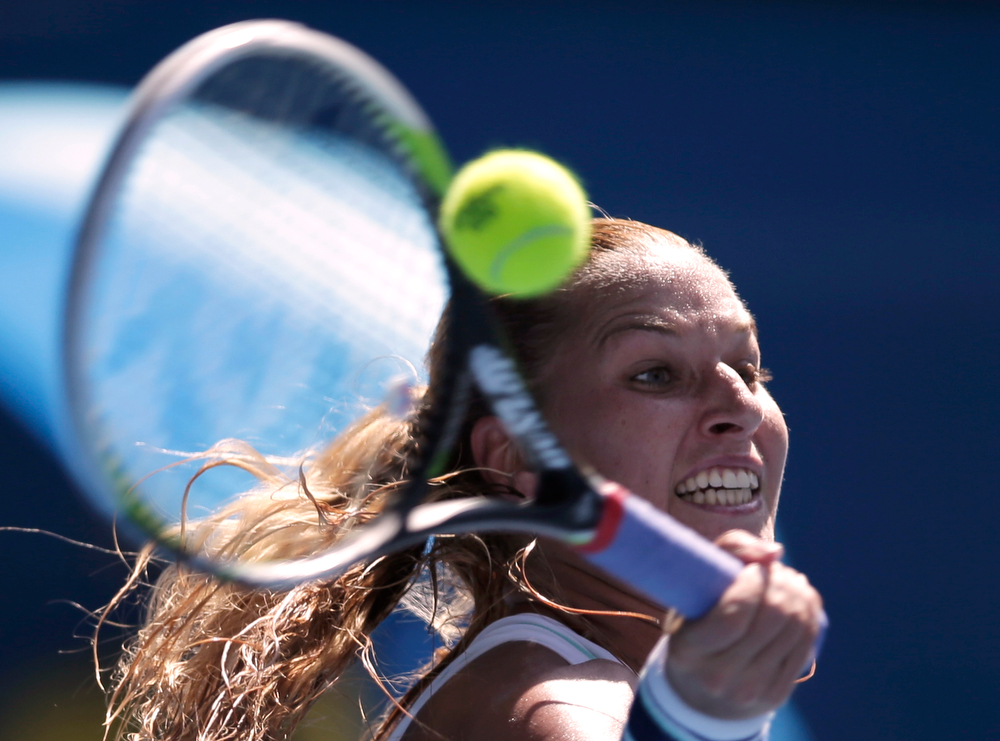 . Dominika Cibulkova of Slovakia makes a forehand return to  Agnieszka Radwanska of Poland during their semifinal at the Australian Open tennis championship in Melbourne, Australia, Thursday, Jan. 23, 2014.(AP Photo/Rick Rycroft)