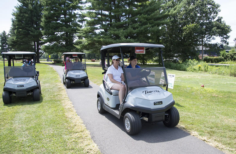 08/05/19  Wesley Bunnell | Staff  Dawn Nielsen, L, and Katie Nielsen drive their cart after teeing off during the women's 9 hole portion of the Bristol Chamber of Commerce's annual golf tournament at Tunxis Country Club on Monday afternoon.