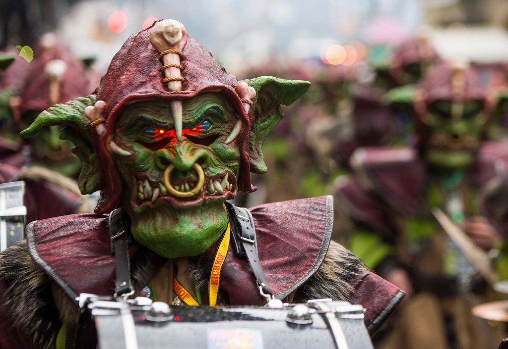 . Carnival participant  wearing A grotesque mask  arriveS to take part in a procession through the historic centre of Lucerne, Switzerland 27 February 2014 at the start of the annual traditional Fasnacht (Carnival) celebrations.  EPA/SIGI TISCHLER