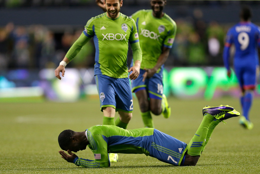 . Seattle Sounders\' Eddie Johnson falls to the ground after scoring a goal against the Colorado Rapids during stoppage time in a knockout-round match in the MLS Cup soccer playoffs, Wednesday, Oct. 30, 2013, in Seattle. The Sounders beat the Rapids 2-0 and will advance to the Western Conference semifinals Saturday, Nov. 2, 2013, for a first of two aggregate match against the Portland Timbers. (AP Photo/Ted S. Warren)