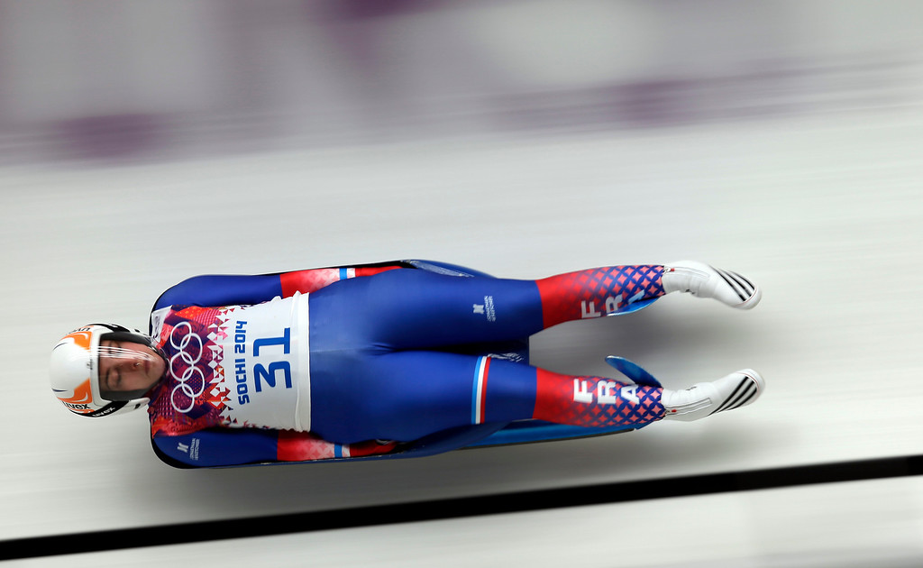 . Morgane Bonnefoy of France speeds down the track in her second run during the women\'s singles luge competition at the 2014 Winter Olympics, Monday, Feb. 10, 2014, in Krasnaya Polyana, Russia. (AP Photo/Michael Sohn)