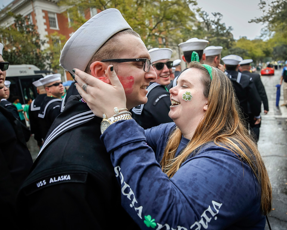 . A sailor from the USS Alaska gets kissed as he marches in the 194-year-old Savannah St. Patrick\'s Day parade, Saturday, March 17, 2018, during the St. Patrick\'s Day parade in Savannah, Ga.  Vice President Mike Pence participated Saturday in the South\'s largest St. Patrick\'s Day parade, where a few lucky fans behind sidewalk barricades got hugs or selfies and a small band of protesters followed nearby waving signs and rainbow flags. (AP Photo/Stephen B. Morton)