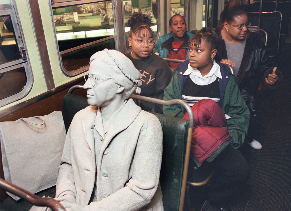 ". Visitors at the National Civil Rights Museum in Memphis listen as recording of a bus driver ""threatens\"" figure of Rosa Parks, left, seated in the front of the bus. The bus, a real Montgomery, Ala., city bus of the 1950s, is one of the displays at the museum, formerly the Lorraine Motel, where Martin Luther King, Jr., was assassinated in 1968. Visiting the bus are, from left front, Sheritha and Quanitha Cobb; at rear, Jerry Mack and Arlene Cobb, all from Dallas, Tex. (AP Photo)"