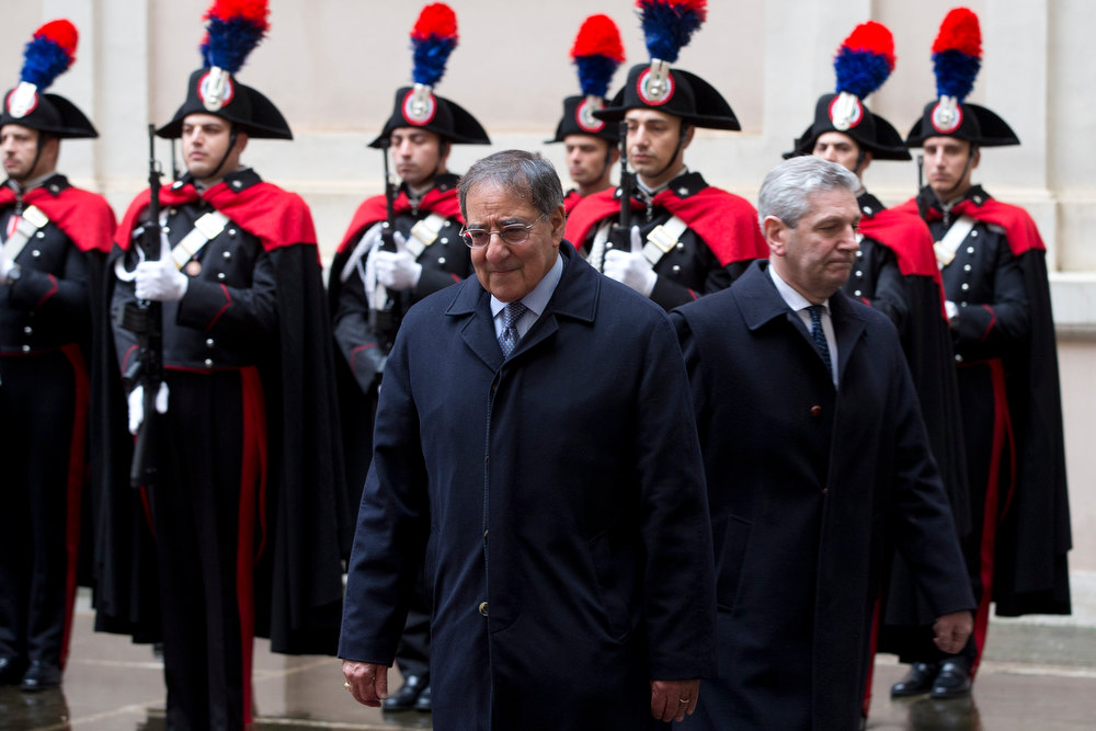 Description of . U.S. Defense Secretary Leon Panetta, left, and Italian Defense Minister Giampaolo Di Paola review a honor guard prior to talks, in Rome, Wednesday, Jan. 16, 2013. Panetta is in Rome as part of a weeklong swing across Europe, meeting with defense ministers to talk about ongoing conflicts in Afghanistan and Mali. This is expected to be Panetta\'s last overseas trip as Pentagon chief, as he long has planned to step down once his replacement is confirmed. (AP Photo/Andrew Medichini)