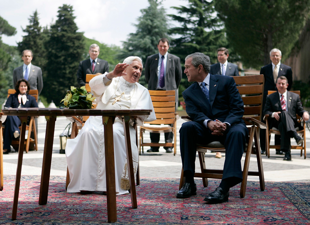 . U.S. President George W. Bush, right, meets with Pope Benedict XVI in the Lourdes Grotto at the Vatican on Friday, June 13, 2008. Pope Benedict XVI gave U.S. President George W. Bush a rare peek on Friday of the Vatican Gardens, a spot where popes pray privately and only special guests are allowed to stroll. (AP Photo/Evan Vucci)