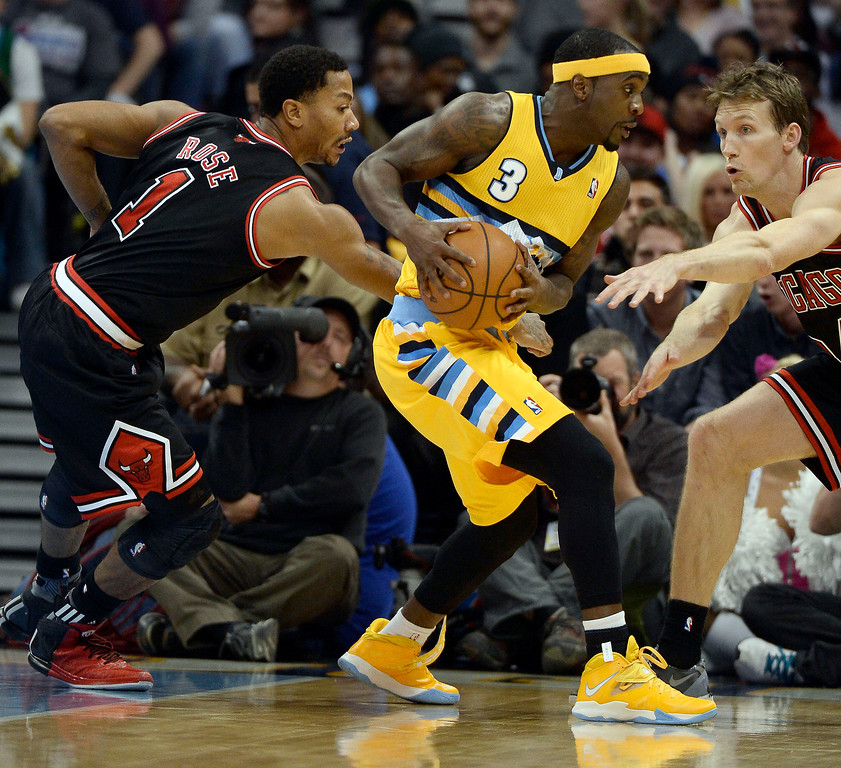 . Denver Nuggets point guard Ty Lawson (3) gets double teamed by Chicago Bulls point guard Derrick Rose (1) and Chicago Bulls small forward Mike Dunleavy (34) during the third quarter November 21, 2013 at Pepsi Center. (Photo by John Leyba/The Denver Post)