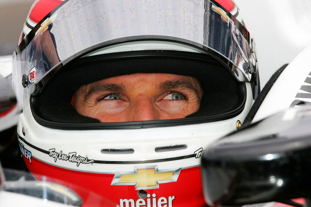 . Team Penske driver Will Power of Australia smiles from behind his driving helmet during a practice session at the Indianapolis Motor Speedway in Indianapolis, Indiana May 16, 2013. The 97th running of the Indianapolis 500 is scheduled for May 26.  REUTERS/Pat Cocciadiferro