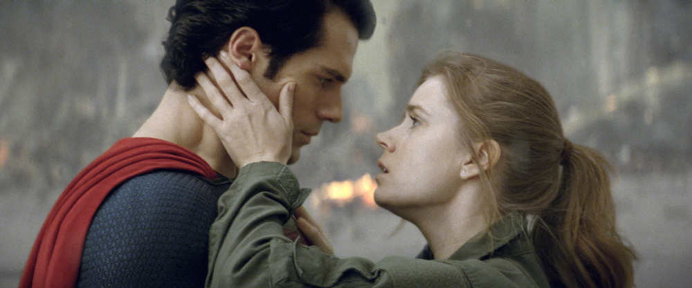 """. This film publicity image released by Warner Bros. Pictures shows Henry Cavill as Superman, left, and Amy Adams as Lois Lane in \""""Man of Steel.\"""" (AP Photo/Warner Bros. Pictures)"""