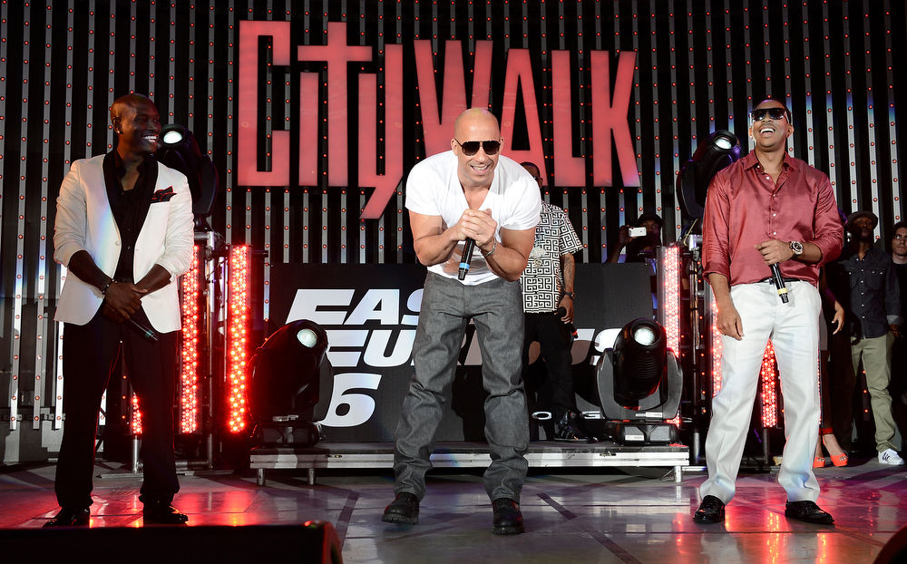 """. From left to right, actor Tyrese Gibson, actor Vin Diesel, and rapper Ludacris perform at the LA Premiere of the \""""Fast & Furious 6\"""" at the Gibson Amphitheatre on Tuesday, May 21, 2013 in Universal City, Calif. (Photo by Dan Steinberg/Invision/AP)"""
