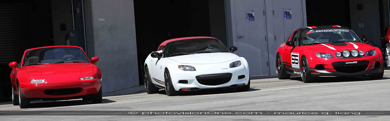 Original Miata from Chicago launch (VIN 17) (left), MX5 Speedster, and club racer MX5.