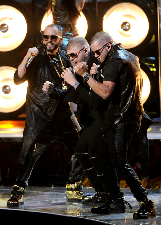 . Yandel, from left, Farruko and El General Gadiel perform at the 15th annual Latin Grammy Awards at the MGM Grand Garden Arena on Thursday, Nov. 20, 2014, in Las Vegas. (Photo by Chris Pizzello/Invision/AP)