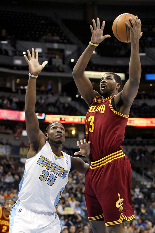 . Tristan Thompson #13 of the Cleveland Cavaliers drives for a shot attempt against Kenneth Faried #35 of the Denver Nuggets at Pepsi Center on January 11, 2013 in Denver, Colorado. (Photo by Chris Chambers/Getty Images)