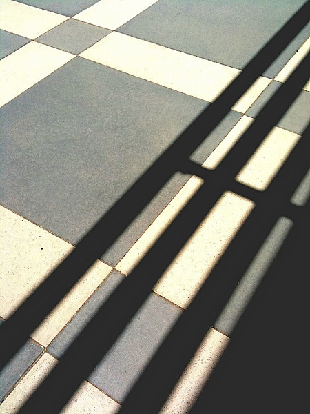 Straight iPhone shot.  Loved the shadows on the geometric cement patio.