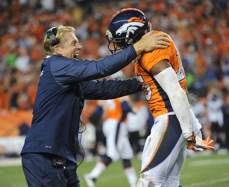 . Defensive coach Jack Del Rio celebrates Denver Broncos cornerback Chris Harris\'s (25) interception in the second quarter. (Photo by Tim Rasmussen/The Denver Post)