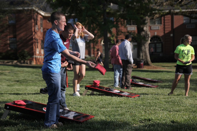 Students participated in corn hole at Dinner on the Quad for listening to NeedToBreathe for Project Rescue