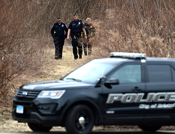 3/11/2020 Mike Orazzi | Staff Bristol police while investigating after a body was discovered along the Pequabuck River near the intersection of Riverside Avenue and Middle Street on Wednesday afternoon.