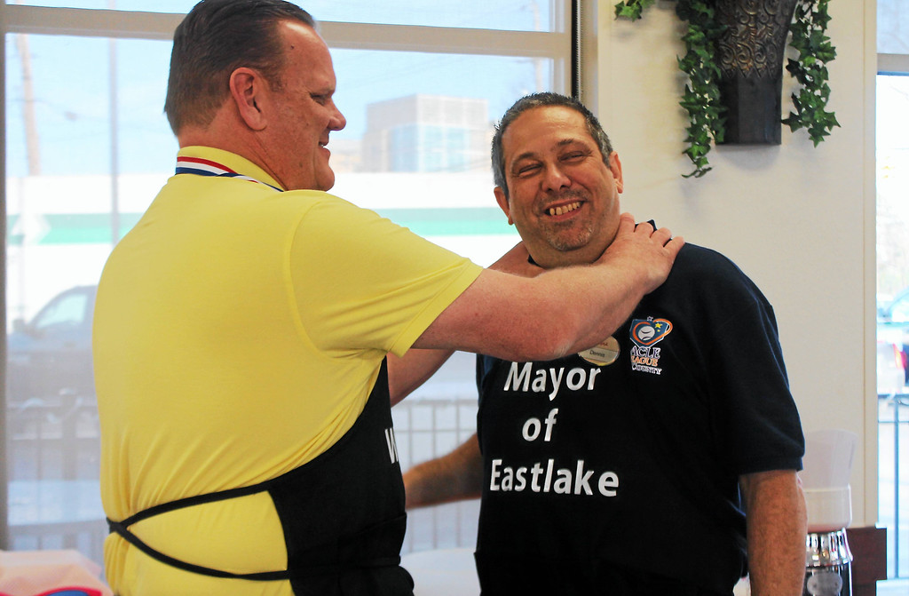 . Kristi Garabrandt � The News-Herald <br> Willowick Mayor Rich Regovich playfully chokes Eastlake Mayor Dennis Morley after Morley was declared the winner of the Lemon Squeeze Battle to benefit Miracle League of Lake County at Chick-Fil-A Willoughby.
