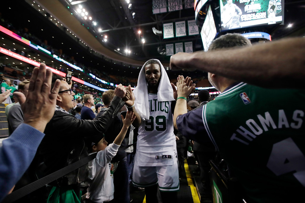. Boston Celtics forward Jae Crowder (99) heads to the locker room after defeating the Washington Wizards in Game 7 of an NBA basketball second-round playoff series Boston, Monday, May 15, 2017. (AP Photo/Charles Krupa)